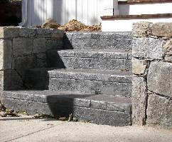Stone wall and stamped concrete steps