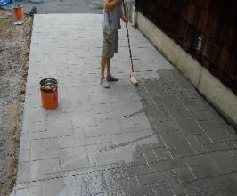 Apllying the acrylic sealer to the stamped concrete.